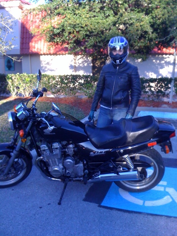 Carey Sparks and our newly-repaired motorcycle!