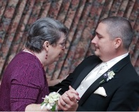 Mom and me dancing at my wedding