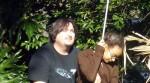 Pushing Ashlee on the swing.